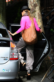 SJP showed off her fabulous street style while out and about in New York City. She toted around her tan leather tote bag while donning a hot pink cardigan.