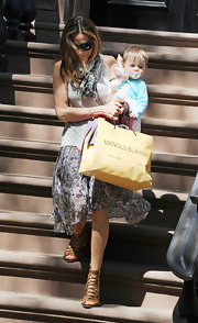 SJP was seen with her adorable daughter while leaving her NYC home. She looked ready for spring in her floral skirt which she paired with a killer pair of lace-up sandals.