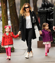 SJP was spotted in a classic black wool coat while out with her darling daughters in NYC.