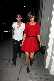 Frankie was a doll in a fitted red dress with a full skirt.