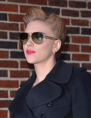 A sizzling Scarlett Johansson struck a pose in gold aviator shades.