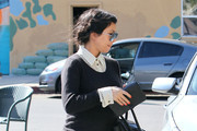 Pregnant reality star Kourtney Kardashian meets up with partner Scott Disick and their son Mason for lunch at Stanley's in Studio City, CA.  The Kardashian's have recently been named in a class action lawsuit alleging their diet pills promise bogus results.