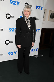 Linda Evans went to the 'Pioneers of Television' photocall wearing a tuxedo-inspired black pantsuit and a printed blouse.