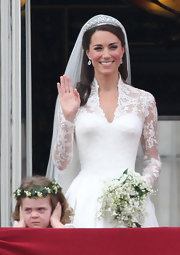 Kate Middleton topped off her Alexander McQueen dress with a tulle veil and a 1930s diamond tiara belonging to Queen Elizabeth II.