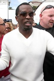 Sean Combs topped off his snazzy ensemble with a pair of aviators while out shopping in Cannes.