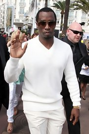 Sean Combs sported a white-on-white look with this V-neck sweater and pants combo while out shopping in Cannes.