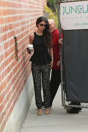 Selena showed off her feminine figure in a waist-cinching peplum top.
