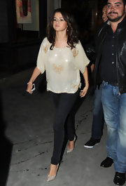 Selena dazzled in a sequined butterfly-embellished blouse.