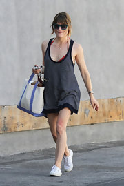 Selma wore this loose, striped cover up while out shopping in Beverly Hills.