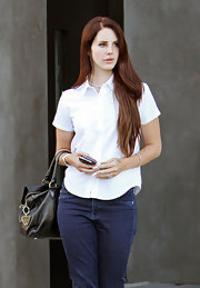 Lana looks simply chic in a crisp short-sleeved button-down.