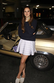 Lana looked casual and summery in this lilac print skirt and cozy sweater.