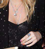 Kesha flaunted a bright multi-colored mani during an appearance at the BBC Radio One studio.