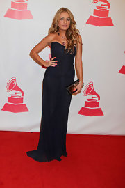 Paulina Rubio wore a structured strapless dress of midnight blue for the Latin Recording Academy event.