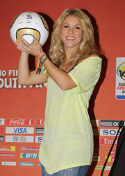 Shakira showed off her colorful bangle bracelets while hitting the World Cup press conference.