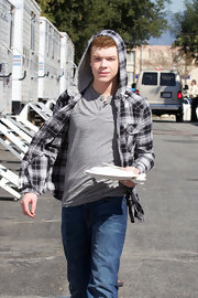 Cameron Monaghan wore a casual plaid hooded button down shirt while on the Emma Greenwell set.