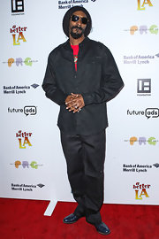 Snoop Lion kept his look casual from head to toe when he sported these black utility pants.