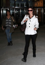 Shannon Elizabeth wore a pair of black lace-up boots when leaving the 'The Wendy Williams Show.'