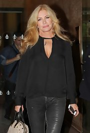Shannon Tweed was seen out in NYC wearing a loose silk top with a sexy cutout detail on the chest.