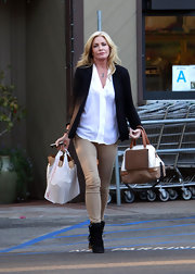 Shannon Tweed had an equestrian vibe while shopping in tan skinny pants and a blazer.