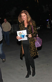 Maria Shriver jazzed up a simple black outfit with a bold animal print coat.