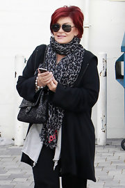 Sharon Osbourne was spotted shopping wearing winter gear including a leopard print scarf around her neck.
