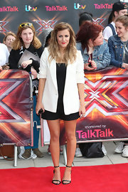 Caroline Flack wore an oversized white blazer over her all-black ensemble at the 'X Factor' photo call in London.