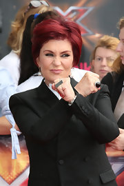 Sharon Osbourne styled her look at the 'X Factor' auditions by wearing a couple of statement jewelry pieces including a domed statement ring.