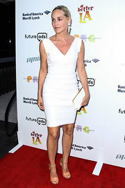 Sharon Stone kept it classy on the red carpet with this fitted white V-neck dress.