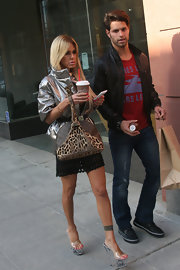 Shauna Sand carried a stylish Louis Vuitton leopard-print tote as she took a stroll in Beverly Hills.