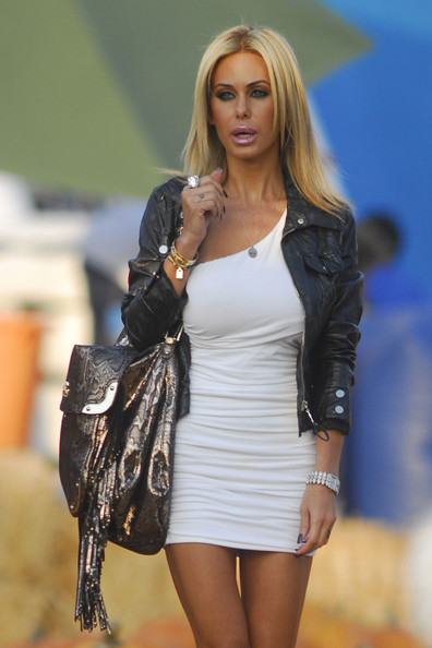 Shauna Sand was rocker-chic in a black leather jacket layered over a one-shoulder mini dress during a visit to a pumpkin patch.