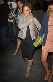 Shawn Johnson was edgy-chic at the 'Dancing with the Stars' season after-party in her beige knee-high boots and gray leather jacket.