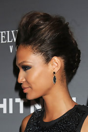 Joan Smalls paired her elegant updo with simple tear drop black earrings.