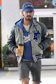 Shia LaBeouf finished off his layered look with a gray track jacket featuring leather sleeves.