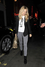 Sienna Miller trekked through London in black leather platform booties.