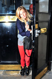 Sienna Miller was spotted exiting the Theatre Royal in black leather moccasins.