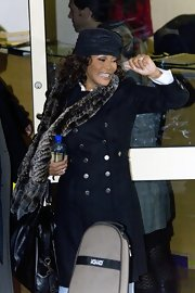 Whitney Houston kept herself warm in a double breasted  wool coat as she left Fountain Studios.
