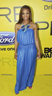 Elise opted for a vibrant blue maxi dress, topped with a statement necklace, for a pre-BET Awards dinner.