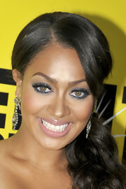 La La Anthony completed her beauty look with a swipe of pale pink lipstick.