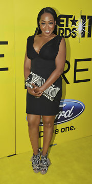 Tichina Arnold showed off her decolletage in a low-cut corset LBD at the pre-BET exclusive dinner.