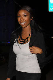 R&B singer Brandy wore a stand out geometric shaped necklace. Pieces such as these really spice up your outfit and saved Brandy's blah tank-top from complete boredom.