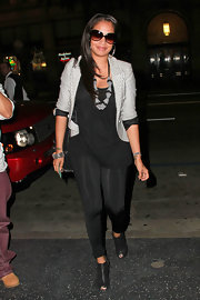 La La Anthony smartened up her outfit with a striped blazer during a night out at Katsuya.