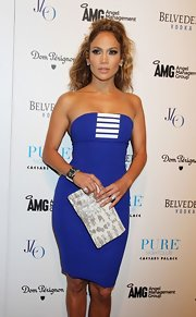 Jennifer Lopez jazzed up her cobalt blue body-huger with a metallic-printed clutch.