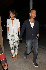Chrissy Teigen added some color to her white blouse with a pair of watercolor floral pants.