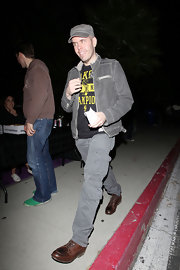 Perez Hilton's edgy yet stylish outfit during Prince's concert consisted of gray cargo pants, a zip-up jacket, and a newsboy cap.