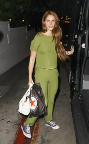 Lana Del Rey was a vision in green, pairing a fitted crop top with matching pants.