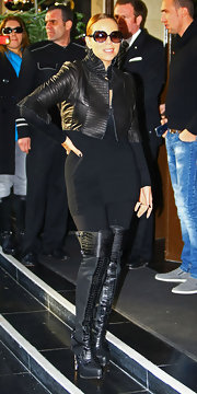 A newly slimmed down Mariah Carey layered a cropped black leather jacket with frilly accents out and about in London.