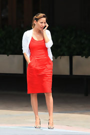 Natalie wears a bright red cocktail dress under a white cardigan while out in Sydney.