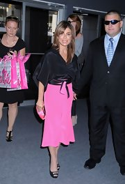 Paula Abdul looked sophisticated and sleek in a silky loose blouse.