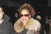 Singer Rihanna is spotted leaving Stringfellows Club in London.   The american singer was spotted leaving the club with heavyweight boxer David Haye.