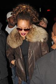 Rihanna stepped out of Stringfellows Club in London wearing a cool leather jacket with fur collar and tinted shades.